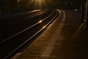Railroad Tracks During Sunset