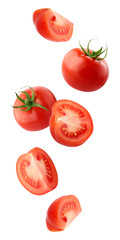 falling tomatoes isolated on a white background with a clipping path.