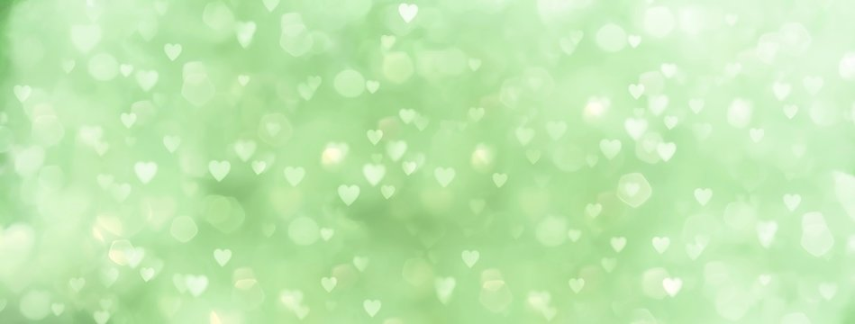 abstract green background with many hearts