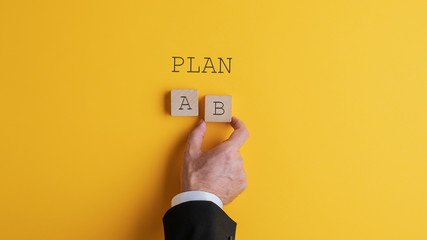 Businessman choosing plan B