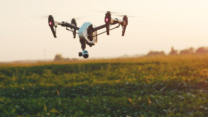Close up smart agriculture drone flying in sky rural aerial helicopter agros copter farm farming field industry landscape meadow nature plant professional vehicle harvest innovation slow motion Fototapete