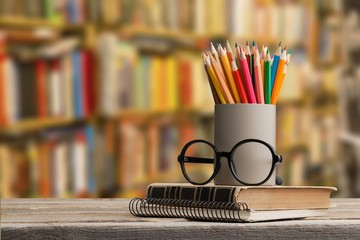 Wall Mural - Stack of books and glasses on wooden desk