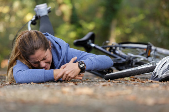 woman with injured wrist after bicycle accident