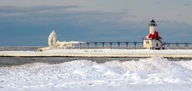 BUILT STRUCTURE BY FROZEN SEA AGAINST SKY
