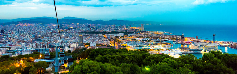 Wall Murals Barcelona HIGH ANGLE VIEW OF ILLUMINATED CITYSCAPE BY SEA AGAINST SKY