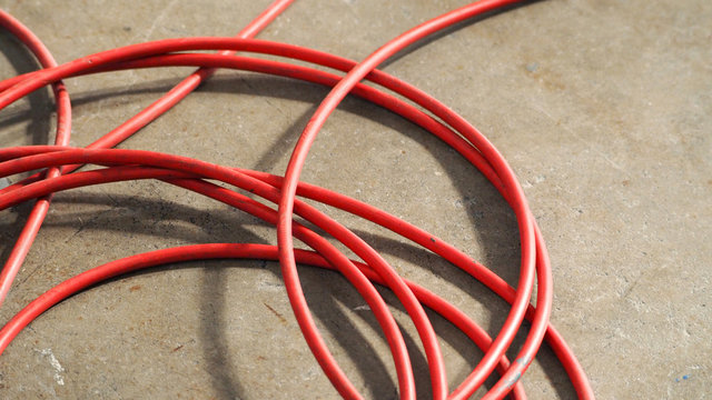 High Angle View Of Red Wires On Street