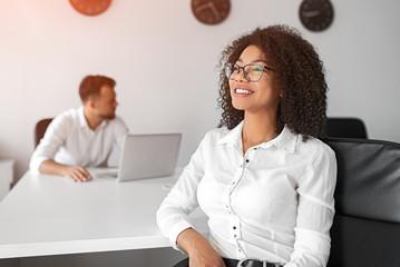 Black woman dreaming in office