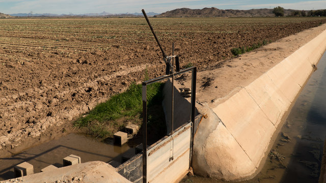 Closed irrigation sluice gate  and canal in farmers field - Arizona