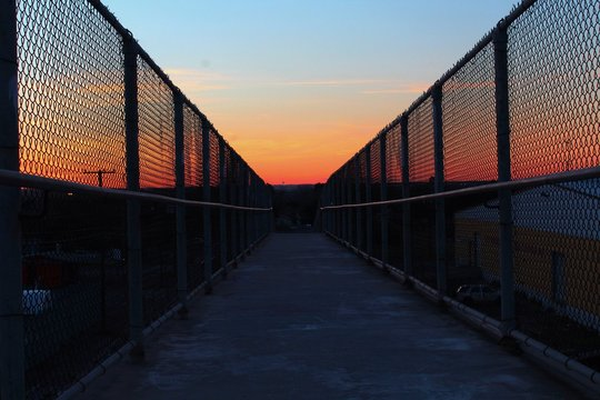 Walkway Against Sky During Sunset