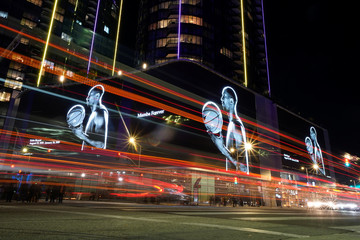 The streets in L.A. are lit up with images of NBA basketball star Kobe Bryant as fans pay their respects outside the Staples Center in Los Angeles