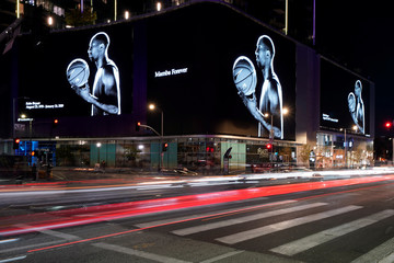The street son L.A. are lit up with images of NBA basketball star Kobe Bryant as fans pay their respects outside the Staples Center in Los Angeles