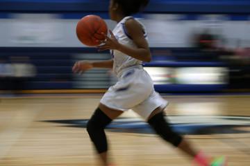 fast break during a girls high school basketball game
