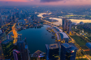 Fototapete - Aerial view of the Singapore landmark financial business district at sunrise scene with skyscraper and beautiful sky. Singapore downtown