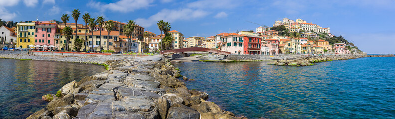 Foto op Aluminium Liguria Panoramic View Of Town By Sea Against Sky