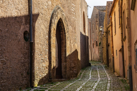 Italy, Sicily, Trapani Province, Erice. A narrow cobblestone street in the ancient hill town of Erice.
