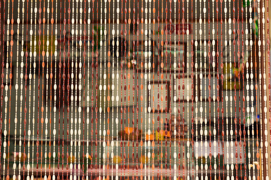 Italy, Sicily, Trapani Province, Erice. Beaded curtain at the entrance to a shop in the hill town of Erice.