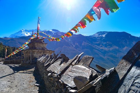 Colorful Prayer Flags Hanging Against Mountains During Sunny Day