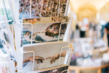 Rome, Italy - Jan 3, 2020: Postcards in a rack in a girft shop inside the Vatican Museum.