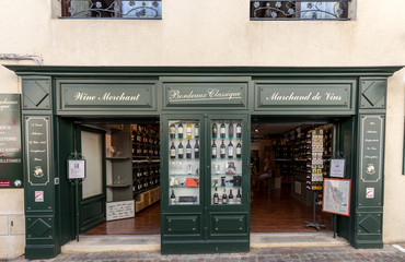 Saint Emilion, France - September 8, 2018: Exterior of a wine shop in Saint Emilion in France. St Emilion is one of the principal red wine areas of Bordeaux and very popular tourist destination.