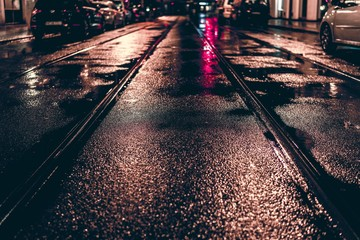 Railroad Tracks On Wet City Street