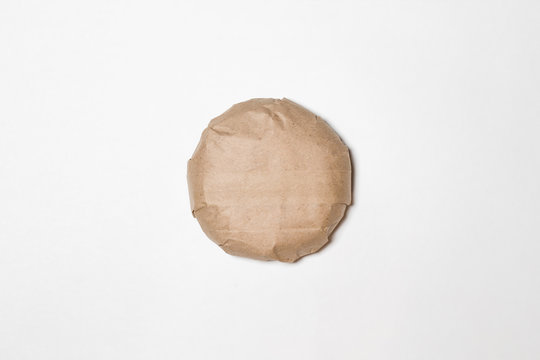 Classic Burger packed in the wrapping paper on white background. Top view. Hamburger Mock up.High resolution photo.