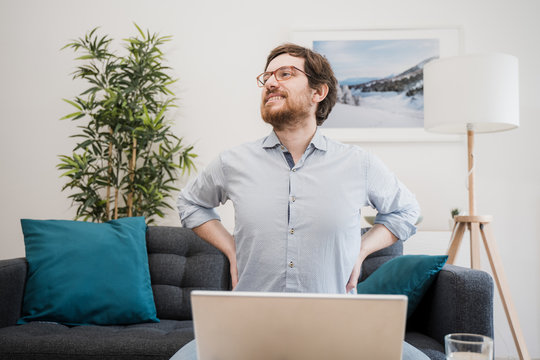 Painful guy aching from pain in back or reins at home
