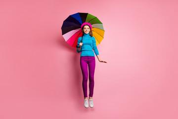 Full length photo of girlish charming girl jump have relax walk on rainy season fall weather hold...