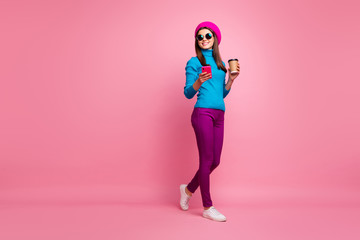 Fototapete - Full length body size view of her she nice attractive lovely pretty slim fit thin cheerful cheery girl holding in hand cell strolling enjoying drinking latte isolated over pink pastel color background