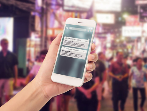 warning alert sms via smart phone for infective outbreak situation on phone screen. catastrophic situation news update system for people