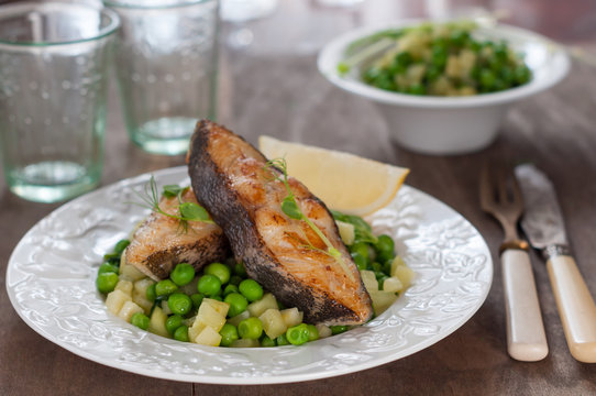 Pan Seared Halibut with Sauteed Peas and Lemon Wedge