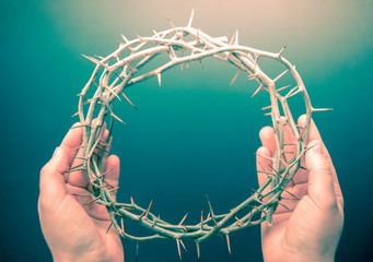 crown of thorns on hands easter background