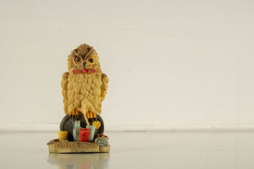 Close-up of clay decoration owl statuette