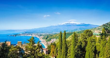 Daylight view of Taormina and beach of Giardini-Naxos located in Metropolitan City of Messina, on east coast of Sicily island, Italy.
