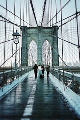 People On Brooklyn Bridge During Winter