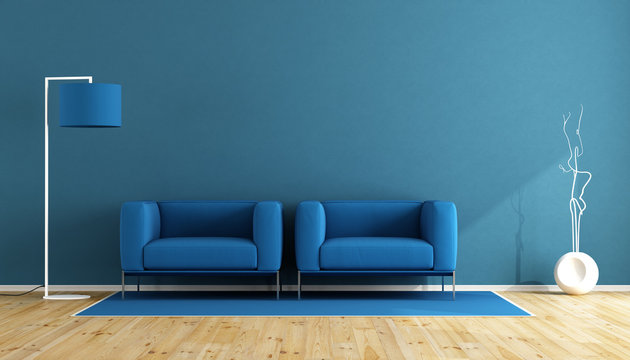 Empty Chairs And Electric Lamp Against Blue Wall At Home