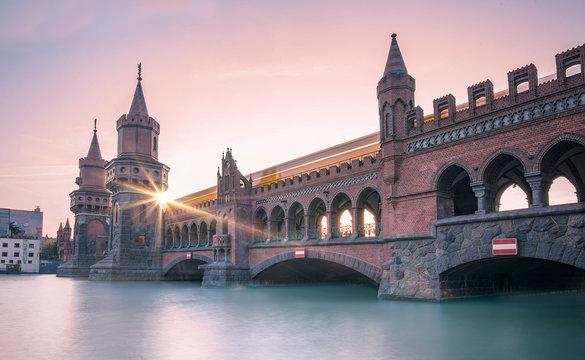 Oberbaumbrucke Bridge Over River During Sunset