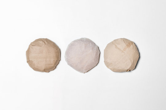 Classic Burgers packed in the wrapping paper on white background. Top view. Hamburgers Mock up.High resolution photo.