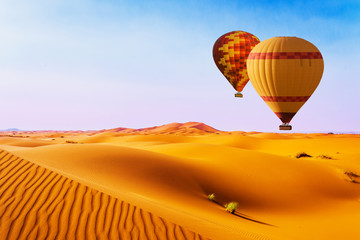 Deurstickers Ballon Desert and hot air balloon Landscape at Sunrise. Travel, inspiration, success, dream, flight concept