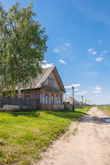 House with a birch in a village