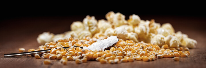 panorama or banner with raw corn and popcorn