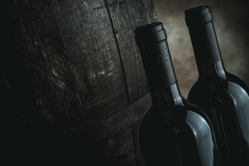 red wine bottles and barrel - desaturated style image