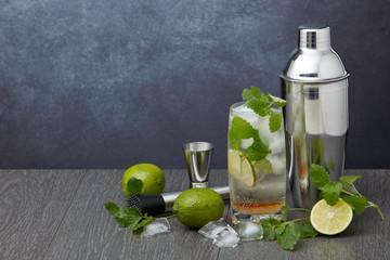 Bar tools and mojito cocktail