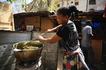 A woman prepares vegetable soup for lunch in Abuja