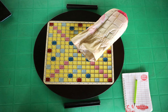 A scrabble board, pouch and writing materials are seen set out on a table during a scrabble competition in Abuja