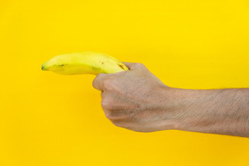 Hold a banana to make some symbol on a yellow background