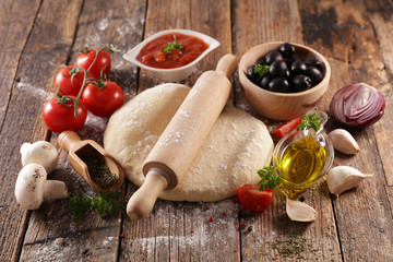 Fotobehang - assorted of pizza dough and ingredient