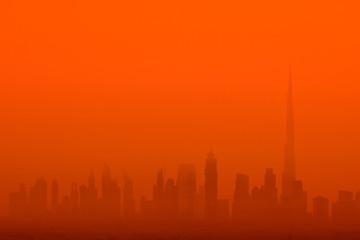 Foto auf Acrylglas Rot SILHOUETTE BUILDINGS AGAINST ORANGE SKY