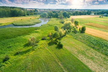 Aerial view of countryside and brook on a spring sunny day. Beautiful nature landscape in spring Fotomurales