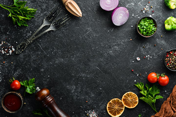 Fotomurales - Black food background. Vegetables and spices on black background. Top view. Free space for your text.