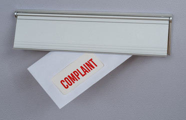 A letter in a mail slot - Complaint Wall mural